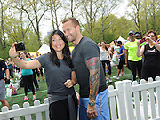 "Joyce Chang, Editor-in-Chief of SELF magazine, takes a selfie with Bob Harper, trainer on ""The Biggest Loser,"" at SELF's 21st annual Workout in the Park, Saturday, May 10, 2014, in New York's Central Park.  (Photo by Diane Bondareff/Invision for SELF/AP Images)"