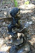 Statue of girl in garden