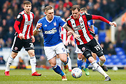 Sheffield United defender Richard Stearman (19) Ipswich Town striker Martyn Waghorn (9) battles for possession during the EFL Sky Bet Championship match between Ipswich Town and Sheffield United at Portman Road, Ipswich, England on 10 March 2018. Picture by Phil Chaplin.