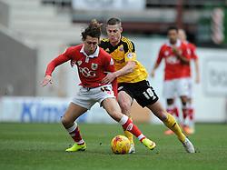 Sheffield United's Paul Coutts fouls Bristol City's Luke Freeman - Photo mandatory by-line: Dougie Allward/JMP - Mobile: 07966 386802 - 14/02/2015 - SPORT - Football - Bristol - Ashton Gate - Bristol City v Sheffield United - Sky Bet League One