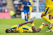 Deji Oshilaja (Capt) (Wimbledon) injured following a tackle with Brandon Hanlan, (Gillingham) during the EFL Sky Bet League 1 match between Gillingham and AFC Wimbledon at the MEMS Priestfield Stadium, Gillingham, England on 8 September 2018.