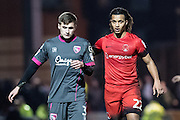 Leyton Orient midfielder Sandro Semedo (22), Morecambe defender Aaron McGowan (3) during the EFL Sky Bet League 2 match between Leyton Orient and Morecambe at the Matchroom Stadium, London, England on 7 February 2017. Photo by Sebastian Frej.