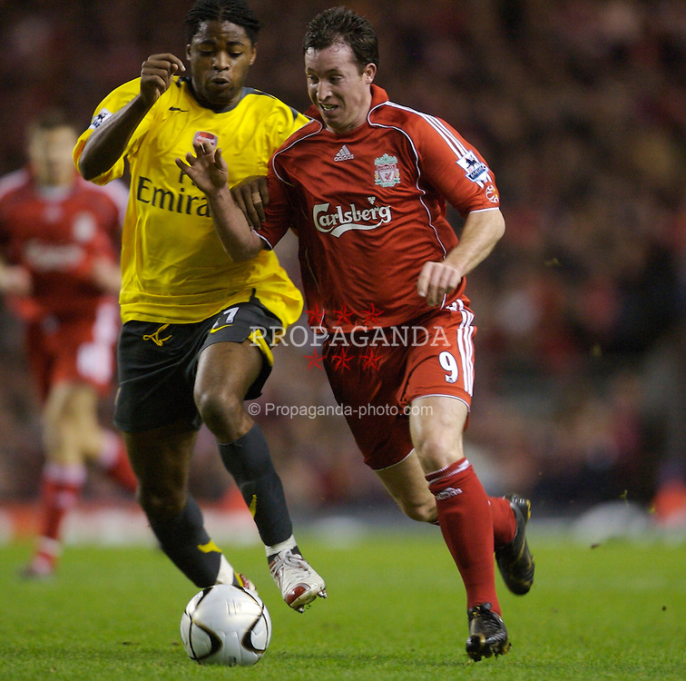 Liverpool, England - Tuesday, January 9, 2007: Liverpool's Robbie Fowler and Arsenal's Alexandre Song Billong during the League Cup Quarter-Final match at Anfield. (Pic by David Rawcliffe/Propaganda)