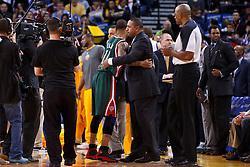 Mar 16, 2012; Oakland, CA, USA; Milwaukee Bucks point guard Monta Ellis (left) hugs Golden State Warriors head coach Mark Jackson (right) before the game at Oracle Arena. Mandatory Credit: Jason O. Watson-US PRESSWIRE