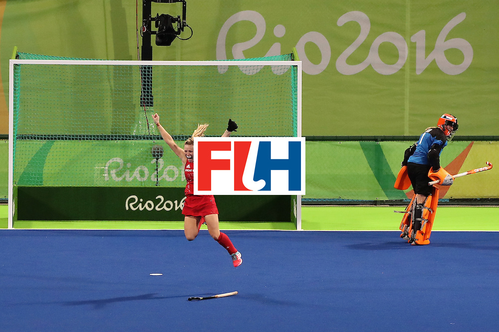 RIO DE JANEIRO, BRAZIL - AUGUST 19:  Hollie Webb of Great Britain celebrates scoring the winning penalty goal past Joyce Sombroek of Netherlands in the Women's Bronze Medal Match on Day 14 of the Rio 2016 Olympic Games at the Olympic Hockey Centre on August 19, 2016 in Rio de Janeiro, Brazil.  (Photo by Mark Kolbe/Getty Images)