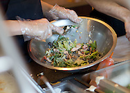 An employee mixes up a salad for a customer at The Prairie Soup Company in Cedar Rapids on Friday, November 11, 2011. (Stephen Mally/Freelance)