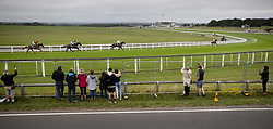 © Licensed to London News Pictures. 04/07/2020. Epsom, UK. Serpentine (R) heads to Victory in The Investec Derby at Epsom - watched by a small locked out crowd from near Tattenham Corner. Today's race meeting is being held behind closed doors due to the coronavirus lockdown rules. Seven races are being held in one day including The Oaks, with The Derby being run at 17:30pm. Photo credit: Peter Macdiarmid/LNP