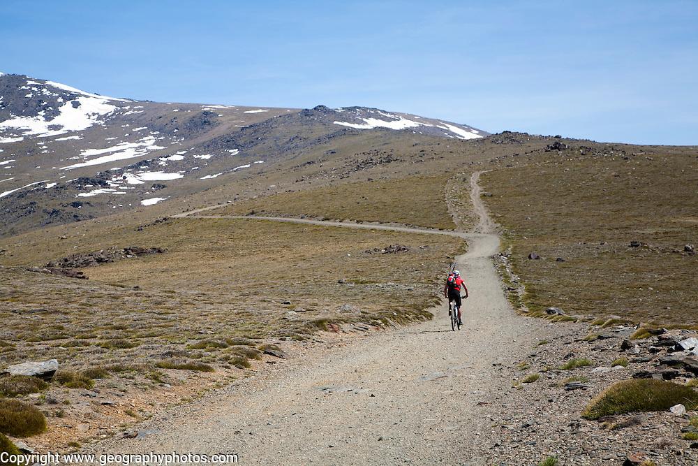 Cycling in the Sierra Nevada Mountains in the High Alpujarras, near Capileira, Granada Province, Spain