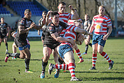 James Bentley (Bradford Bulls) tackles Richard Lepori (Oldham Roughyeds) during the Kingstone Press Championship match between Oldham Roughyeds and Bradford Bulls at Bower Fold, Oldham, United Kingdom on 2 April 2017. Photo by Mark P Doherty.