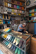 """Leather worker prepares slippers or """"babouche"""", Fes el Bali"""