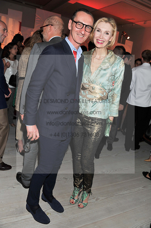 BRUNO FRISONI and ALLEGRA HICKS at a party hosted by Ines de la Frassange and Bruno Frisoni for Roger Vivier to launch the Roger Vivier book held at The Saatchi Gallery, London on 24th April 2013.