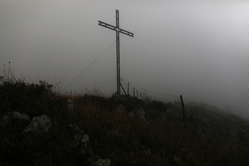 A cross stands on a hilltop near the town of Rocca Calascio in the province of L'Aquila in Abruzzo.