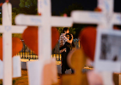 October 6, 2017 - Las Vegas, California, U.S. - A couple embraces and cries at a memorial where crosses honoring the Route 91 Harvest festival victims are placed at Welcome to Fabulous Las Vegas sign site. The crosses were brought by Greg Zanis, of Illinois, to honor the 58 Las Vegas shooting victims. (Credit Image: © Rachel Luna//The Orange County Register via ZUMA Wire)