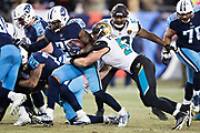 NASHVILLE, TN - DECEMBER 31:  Derrick Henry #22 of the Tennessee Titans runs the ball and is tackled by Paul Posluszny #51 of the Jacksonville Jaguars at Nissan Stadium on December 31, 2017 in Nashville, Tennessee.  The Titans defeated the Jaguars 15-10.  (Photo by Wesley Hitt/Getty Images) *** Local Caption *** Derrick Henry; Paul Posluszny