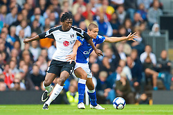 LONDON, ENGLAND - Sunday, September 13, 2009: Everton's Jack Rodwell and Fulham's Dickson Etuhu during the Premiership match at Craven Cottage. (Photo by David Rawcliffe/Propaganda)