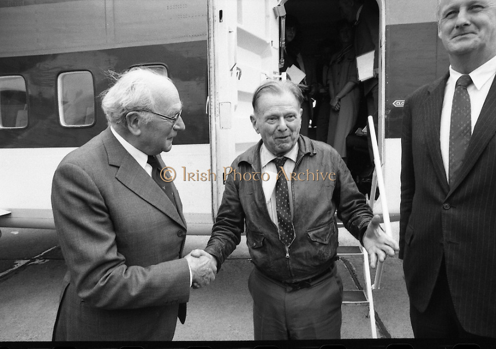 """""""Wrongway Corrigan"""" at Baldonnell.  (R84)..1988..18.07.1988..07.18.1988..18th July 1988..Douglas """"Wrongway"""" Corrigan returned to Baldonnell Airdrome 50 years after his transatlantic flight in a Curtiss Robin aircraft. After a transcontinental flight from California to New York, Mr Corrigan was to make a return flight to California. However on take off he took off over the Atlantic to Ireland. He had been refused permission from American authorities to fly solo to Ireland. On Arrival in Ireland he maintained that bad weather conditions and compass malfunction were the reason for his """"wrongway' flight..In 1938 he was met by Mr R W O'Sullivan as he disembarked from his plane..Comdt D K Johnston, Irish Air Corps flew in formation with Mr Corrigan in Irish Airspace..Mr J Maher,Aer Lingus Chief Engineer,hangared the aircraft on arrival and Mr V Ellis of Oriole Steamship Lines was responsible for the transportation of the aircraft back to the U.S. aboard the S S Lehigh.  These gentlemen were here today to meet again with Mr Corrigan...Image shows Mr Corrigan being greeted by Mr Richard O'Sullivan who was the first person to greet him 50 years ago.Included in the picture is Mr David Kennedy, CEO, Aer Lingus."""