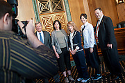 Montana Senator Jon Tester (D) has his photo taken with constituants  during the Montana coffee hour on Capitol Hill.