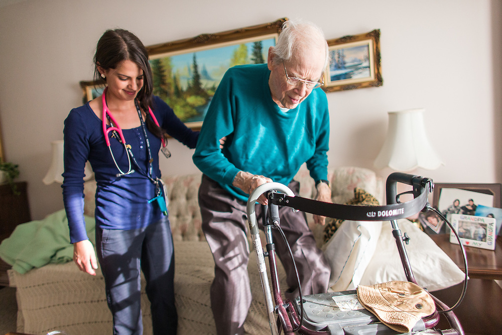 Strathroy, Ontario ---2015-05-13--- Becky Rutherford, a palliative care nurse with the VON Palliative Care Team helps Phillip McDonnell stand during a visit to his apartment in Strathroy, Ontario, May 13, 2015.<br /> GEOFF ROBINS The Globe and Mail