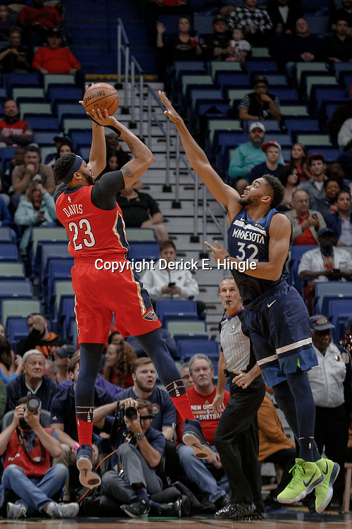 Nov 29, 2017; New Orleans, LA, USA; New Orleans Pelicans forward Anthony Davis (23) shoots over Minnesota Timberwolves center Karl-Anthony Towns (32) during the first quarter of a game at the Smoothie King Center. Mandatory Credit: Derick E. Hingle-USA TODAY Sports