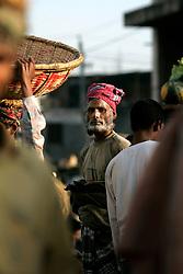BANGLADESH DHAKA KAWRAN BAZAAR 27FEB05 - Porters at work in the Kawran Bazaar vegetable market. The Bazaar has been in the Tejgaon area for at least 30 years and is one of the largest markets in Dhaka city...jre/Photo by Jiri Rezac ..© Jiri Rezac 2005..Contact: +44 (0) 7050 110 417.Mobile:  +44 (0) 7801 337 683.Office:  +44 (0) 20 8968 9635..Email:   jiri@jirirezac.com.Web:    www.jirirezac.com..© All images Jiri Rezac 2005- All rights reserved.