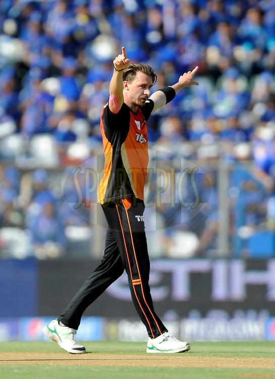 Dale Steyn of Sunrisers Hyderabad celebrates the wicket of Parthiv Patel of Mumbai Indians during match 23 of the Pepsi IPL 2015 (Indian Premier League) between The Mumbai Indians and The Sunrisers Hyferabad held at the Wankhede Stadium in Mumbai India on the 25th April 2015.<br /> <br /> Photo by:  Pal Pillai / SPORTZPICS / IPL