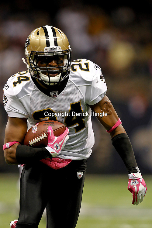 October 23, 2011; New Orleans, LA, USA; New Orleans Saints cornerback Leigh Torrence (24) returns an interception for a touchdown against the Indianapolis Colts during the third quarter of a game at the Mercedes-Benz Superdome. The Saints defeated the Colts 62-7. Mandatory Credit: Derick E. Hingle-US PRESSWIRE / © Derick E. Hingle 2011