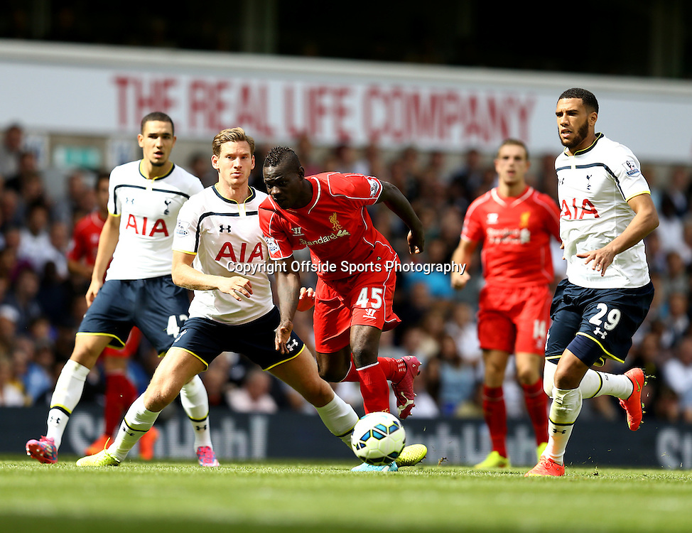 31 August 2014 - Barclays Premier League - Tottenham Hotspur v Liverpool - Mario Balotelli of Liverpool takes on Nabil Bentaleb, Jan Vertonghen and Etienne Capoue of Tottenham Hotspur - Photo: Marc Atkins / Offside.