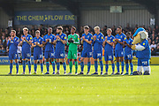 AFC Wimbledon players stood in line clapping during the EFL Sky Bet League 1 match between AFC Wimbledon and Portsmouth at the Cherry Red Records Stadium, Kingston, England on 19 October 2019.