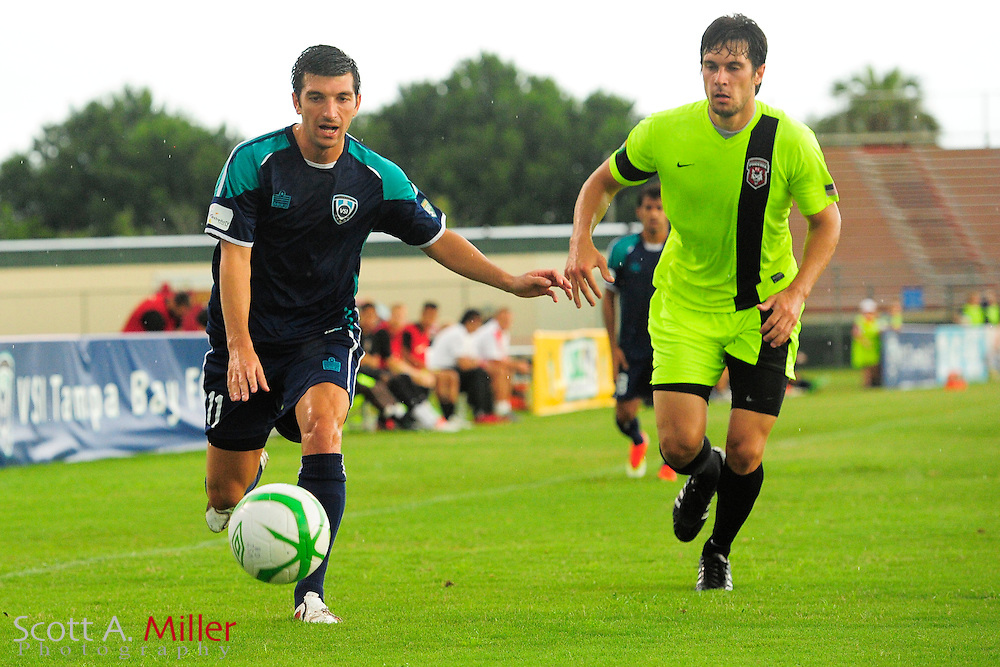 VSI Tampa Bay FC midfielder Tony Donatelli (11) in action against the Phoenix FC Wolves in a USL Pro soccer match at Plant City stadium in Plant City, Florida on June 9, 2013.<br /> <br /> &copy;2013 Scott A. Miller