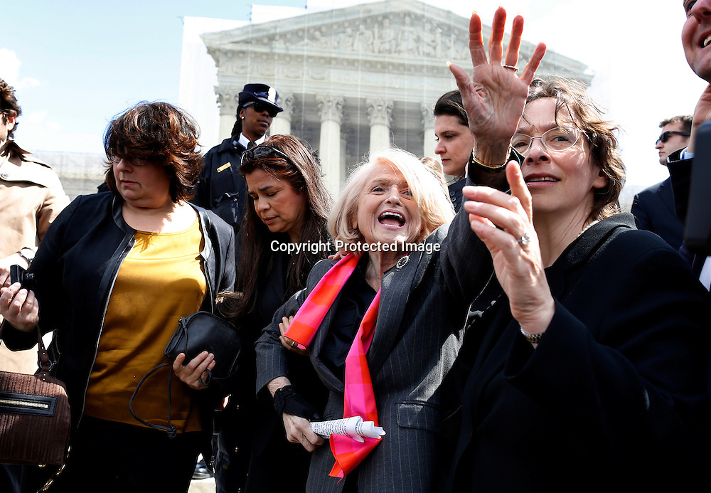 Plaintiff Edith Windsor waves triumphantly to supporters outside the Supreme Court after arguments in her case against the Defense of Marriage Act. Windsor brought the case after the federal government denied her the same tax relief as heterosexual couples, after the death of her longtime partner.