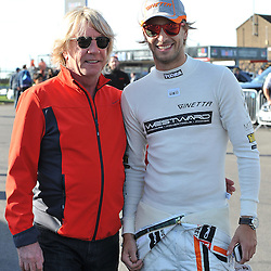 Rick Parfitt with his son Rick Parfitt jnr.<br /> Taken during the final round of the Avon Tyres British GT Championship held at Donington Park race track, Leicestershire on the 6th October 2013.<br /> WAYNE NEAL | SPORTPIX.ORG.UK