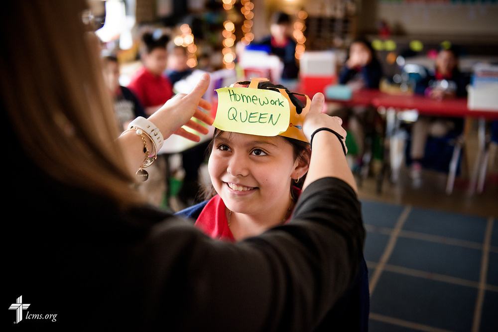 Fourth grade teacher Amanda Stewart crowns a student for an achievement at St. Martini Lutheran School on Tuesday, Nov. 14, 2017, in Milwaukee. LCMS Communications/Erik M. Lunsford