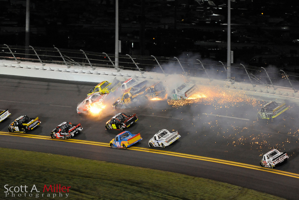NASCAR Camping World Truck Series drivers Travis Kvapil (5), Ron Hornaday (33), Brendan Gaughan (62), Jason White (23), Shane Sieg (93), Todd Bodine (30) and T.J. Bell (50) are involved in a multi truck crash during the NextEra Energy Resources 250 at the Daytona International Speedway on Feb. 18, 2011 in Daytona Beach, Fl...©2011 Scott A. Miller