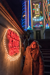 """© Licensed to London News Pictures. 01/12/2017. London, UK.  Alan Kane's new work, """"Home for Christmas"""", is unveiled at Tate Britain.  """"Home for Christmas"""" transforms the exterior of the gallery into a glowing display of off-the shelf decorations with an arrangement of LED Santas, reindeer, snowmen and Christmas trees, along with 'Merry Christmas' and 'Santa Stop Here' signs.  The artwork will be switched on daily from 2 December 2017 to 6 January 2018.  Photo credit: Stephen Chung/LNP"""