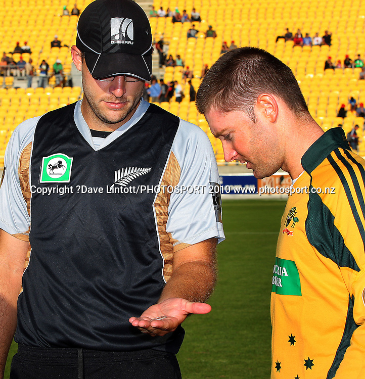 Australian captain Michael Clarke inspects Daniel Vettori's coin before the toss.<br /> 1st Twenty20 cricket match - New Zealand v Australia at Westpac Stadium, Wellington. Friday, 26 February 2010. Photo: Dave Lintott/PHOTOSPORT