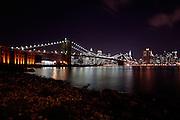 Manhattan, New York, USA, 20080312:   Brooklyn Bridge and Manhattan Financial district by night.<br /> <br /> Photo: Orjan F. Ellingvag