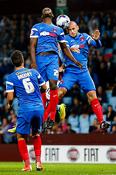 Marvin Bartley and Scott Cuthbert of Leyton Orient jump to clear from an Aston Villa corner - Photo mandatory by-line: Rogan Thomson/JMP - 07966 386802 - 27/08/2014 - SPORT - FOOTBALL - Villa Park, Birmingham - Aston Villa v Leyton Orient - Capital One Cup Round 2.
