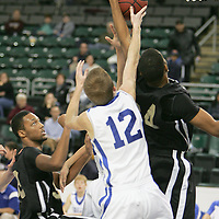 Forward Demond Tillman (24) is stopped by Blue Jay guard Matt McCarthy (12) at the basket.