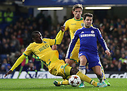 Chelsea's Cesc Fàbregas wins the ball from Sporting Lisbon's William Carvalho during the UEFA Champions League match between Chelsea and Sporting Lisbon at Stamford Bridge, London, England on 10 December 2014.
