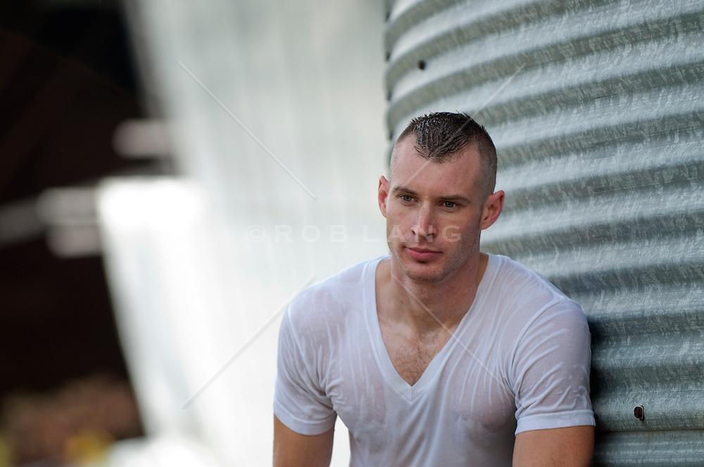 man in a tee shirt wet outdoors
