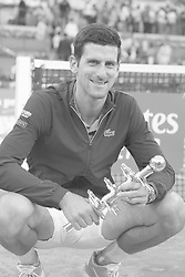 May 12, 2019 - Madrid, Spain - (EDITOR'S NOTE: Image was converted to black and white)  Novak Djokovic of Serbia celebrates victory in his men's singles final against Stefano Tsitsipas of Greece during day nine of the Mutua Madrid Open at La Caja Magica on May 12, 2019 in Madrid, Spain  (Credit Image: © Oscar Gonzalez/NurPhoto via ZUMA Press)