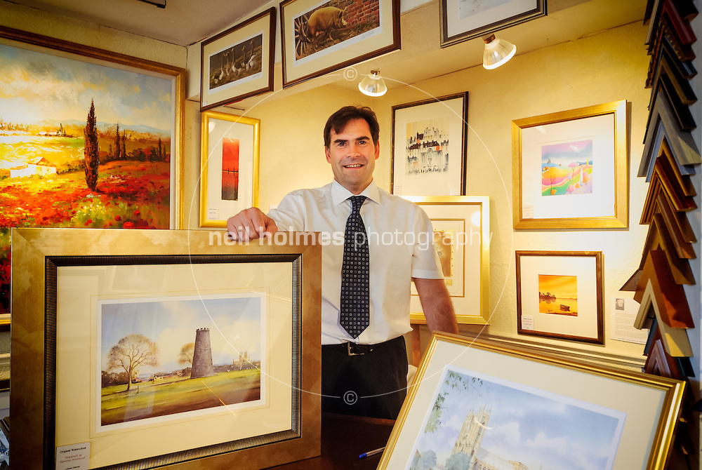 August 13, 2008. Pictured: David Elwell proprietor of Lairgate Galleries with water colours of the old mill on the Westwood and the Minster.