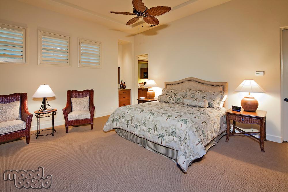 Spacious bedroom interior of luxury mansion