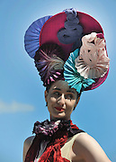 © licensed to London News Pictures. EPSOM, UK.  03/06/11. Erin O'Conner, supermodel, wears a bespoke creation by milliner, Louis Mariette and a dress by Felicity Brown. Epsom Derby Ladies Day. Sunshine and wind made for a busy Ladies Day today, 3rd June 2011.  Photo credit should read Stephen Simpson/LNP