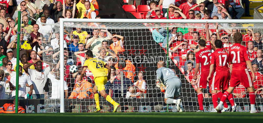 LIVERPOOL, ENGLAND - Sunday, August 15, 2010: Liverpool's goalkeeper Pepe Reina fumbles the ball into the back of his own net to gift Arsenal an equalising goal in the dying minuets of the Premiership match at Anfield. (Pic by: David Rawcliffe/Propaganda)