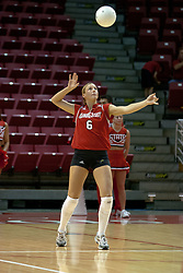 20 November 2004....Kelly Rikli concentrates as the ball descends for her serve....Illinois State University Redbirds V Drake Bulldogs Women's Volleyball.  Redbird Arena, Illinois State University, Normal IL