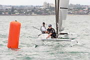 Peter Burling (NZL275), race one of the A Class World championships regatta being sailed at Takapuna in Auckland. 11/2/2014