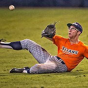 A Cal State Fullerton player makes a sliding catch Friday night vs. Cypress College