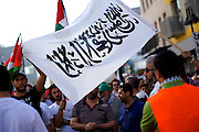 Mainz | 18 July 2014<br /> <br /> Am Samstag (18.07.2014) nahmen etwa 1000 M&auml;nner, Frauen und Kinder in der Innenstadt von Mainz anl&auml;sslich der milit&auml;rischen Auseinandersetzung zwischen Israel und der Hamas in Gaza an einer Solidarit&auml;tsdemonstration f&uuml;r Gaza, ein freies Pal&auml;stina und gegen Israel teil. Bei der Demo wurden Fahnen der Hamas und der Hisbollah mitgef&uuml;hrt, neben den &uuml;blichen Parolen gegen Israel wurde in Sprechch&ouml;hren auch vereinzelt zur Vernichtung von J&uuml;dinnen und Juden aufgerufen.<br /> Hier: Ein junger Mann mit Fahne.<br /> <br /> <br /> &copy;peter-juelich.com<br /> <br /> [No Model Release | No Property Release]