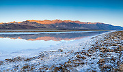 The Amargosa Mountains reflect on Badwater Salt Flat in Death Valley National Park, during rare flood conditions in the spring of 2010. At 282 feet below sea level, BadWater is the lowest point in North America.
